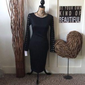 Jennifer Lopez body con black laced sleeves dress